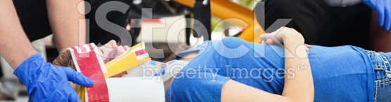 stock-photo-20580460-woman-in-an-ambulance-stretcher-being-treated-by-medicscropped
